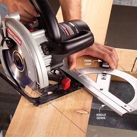 <b>Photo 1: Line up the saw and guide</b></br> Align the blade with the cutting line and slide the square up to the saw's base. Grip the guide firmly against the board.