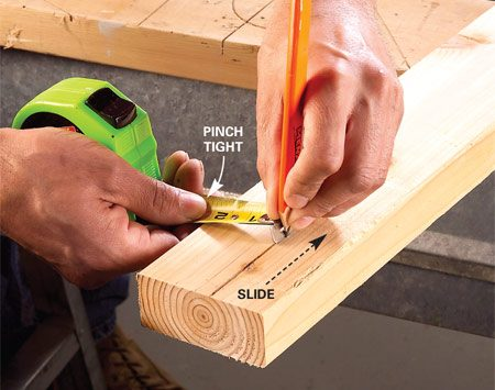 <b>Photo 1: Mark the cut</b></br> Mark the rip width on the board and line up the end of the tape with the mark. Pinch the tape and slide it along the edge of the board while holding a pencil tight to the end of the tape.