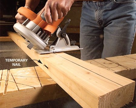 <b>Photo 2: Secure the board</b></br> Tack the board to the sawhorses. Set the saw to the desired bevel and set the blade depth to 1/4 in. deeper than the thickness of the board. Saw along the line using the notch or line on the saw's base to help guide the cut.