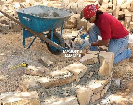 <b>Photo 14: Set large stones first</b></br> Chip away the edge of stones with the glancing blow of a mason's hammer to get a better fit. Stagger the vertical joints by at least 2 in. when possible. Set large stones first and fill in the spaces with smaller ones.