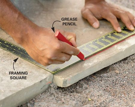 <b>Photo 21: Mark cuts in place</b></br> Cut stones to keep the layout regular and the joint width even. Mark the stones to be cut in place, using a framing square and grease pencil or crayon.