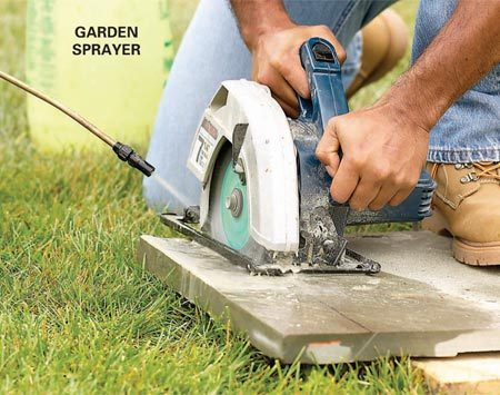 <b>Photo 22: Cut stones with a circular saw</b></br> Cut the stone with a circular saw and a diamond-grit masonry blade. Wear eye protection. Control the dust by spraying the blade with a mist of water from a garden sprayer.