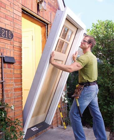 How to replace an exterior door the family handyman for Front entry door installation