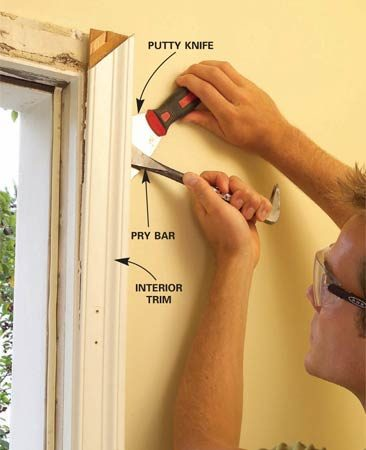 <b>Photo 2: Pry loose the old trim</b></br> Pry the interior trim loose from the door frame. Protect the wall with a wide putty knife. If you plan to reuse the trim, first score the intersection between the molding and jamb with a utility knife.