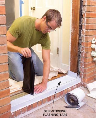 <b>Photo 6: Install flashing tape</b></br> Cover the rough sill area with self-sticking flashing tape. Wrap it up the sides of the opening and over the front edge. Set the door in the opening, plumb it and check the fit.