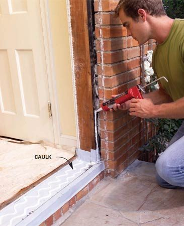 <b>Photo 7: Apply caulk</b></br> Apply a bead of caulk along the sides and top of the door opening and at the sill according to the manufacturer's instructions.