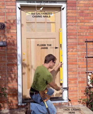 <b>Photo 8: Tack in the door</b></br> Make sure the doorsill is level. Then center the top of the door in the opening and tack it into place with galvanized casing nails. Plumb the hinge-side jamb and tack the bottom corners.
