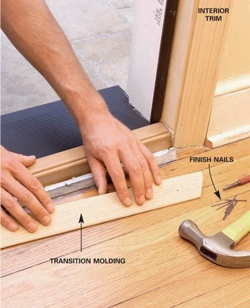 <b>Photo 13: Install interior trim</b></br> Cut and install new interior trim or reinstall the old trim. If there's a gap between the new sill and the existing flooring, cover it with a beveled transition.