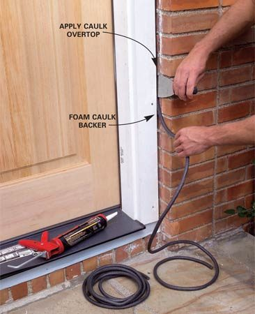 <b>Photo 14: Apply caulk backer and caulk</b></br> Press foam caulk backer into the siding/trim gap. Apply a neat bead of caulk between the siding and the door trim. Cut a trim board to fit under the sill and screw it to the framing