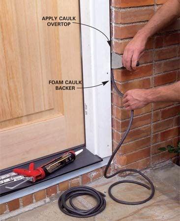 <b>Photo 14: Apply caulk backer and caulk</b></br> Press foam caulk backer into the siding/trim gap. Apply a neat bead of caulk between the siding and the door trim. Cut a trim board to fit under the sill and screw it to the framing