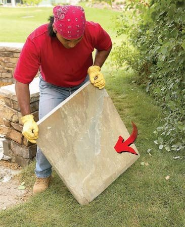 <b>Tip the stone up</b></br> Tip the stone on one edge and tilt it to one side.