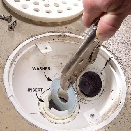 <b>Photo 2: Screw in the insert</b></br> Drop the ball into the drain and screw in the insert. A 2-in. or larger washer lets you turn the insert with pliers.