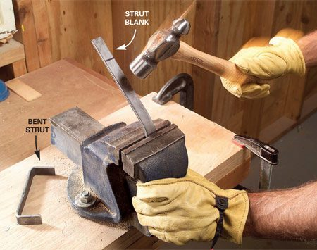 <b>Photo 8: Bend the struts</b></br> Cut the 8-in. long struts from 1/8-in. x 3/4-in. steel with your hacksaw. Place a mark 1-1/2 in. from each end. Align the marks with the vise jaws, tighten and then hammer the piece to form crisp 90-degree bends. Center and drill bolt holes according to the strut detail in Figure A.
