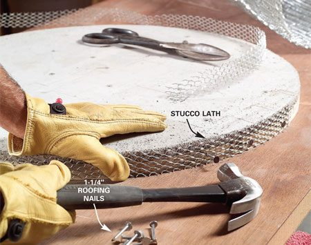 <b>Photo 12: Attach lath</b></br> Cut 1-3/8 in. strips of galvanized expanded metal lath (stucco lath) 7 ft. long. Nail the strips to the edge of the disc. Use 1-1/4 in. galvanized roofing nails and space them every 4 in.