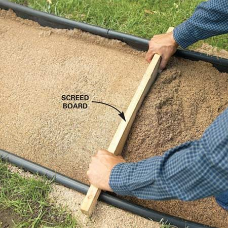 <b>Photo 7: Screed</b></br> Pull the screed board along the edging to level and smooth the sand 4 in. below the top of the tube. Fill and tamp any low spots.