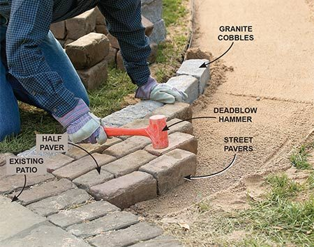 <b>Photo 9: Set the pavers with staggered joints</b></br> Set the pavers beginning at the most visible end. Stagger the joints one-half paver. Set each one in the sand with a few whacks of a deadblow hammer.
