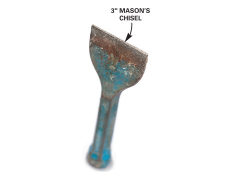 <b>Mason's chisel</b></br> Use a 3-in. mason's chisel to score and cut the pavers