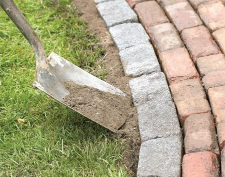 <b>Photo 14: Fill the sides</b></br> Fill in along the side of the path with topsoil and tamp firmly with your foot.