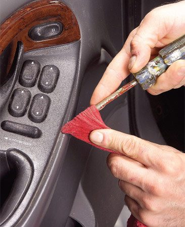 <b>Photo 4: Clean the dash details</b><br/>A flat screwdriver and a rag cleans most dash details.