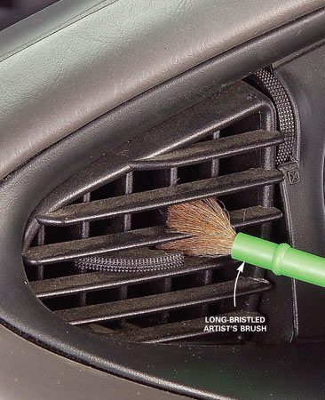 <b>Photo 5: Brush out the air vents</b><br/>A  long-bristled artist&rsquo;s brush and furniture polish removes dust well.