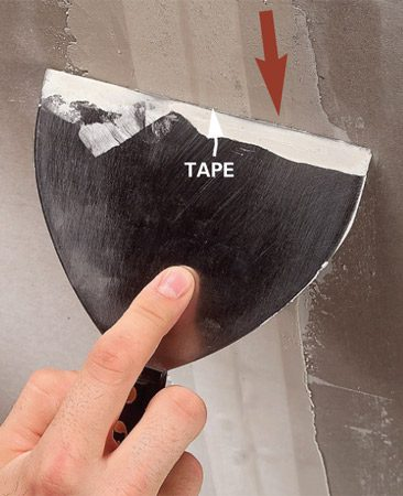 <b>Photo 4: Tape and smooth</b></br> Lay on the tape and apply a smooth, thin layer of compound over the tape.
