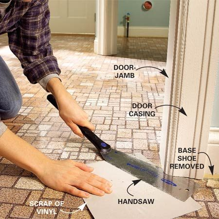 <b>Photo 1: Undercut the door moldings and jambs</b></br> Saw off the bottoms of the doorjambs and moldings. Use a scrap of vinyl flooring to position the saw blade the correct distance from the floor. Remove the base shoe.