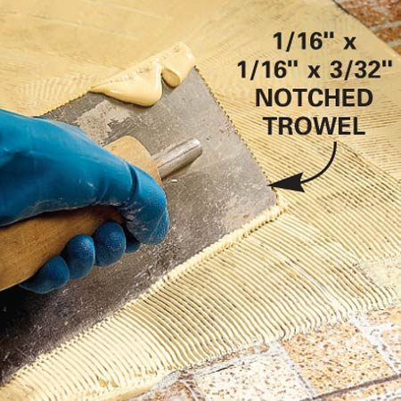 <b>Close-up: Notched trowel</b></br> 1/16 in. x 1/16 in. x 3/32 in. notched trowel