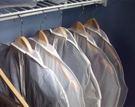 <b>Enclose the clothes you rarely wear</b></br> Enclose rarely worn clothes in garment or garbage bags.