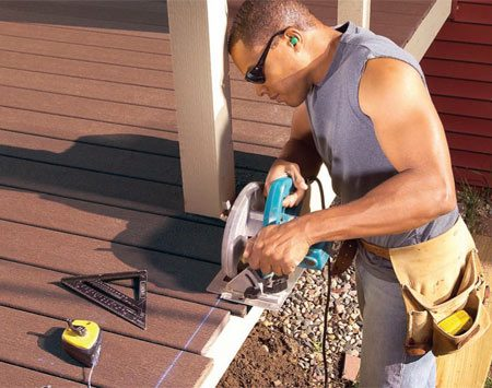 <b>Photo 9: Trim the ends</b></br> Snap a line on the ends 1 in. beyond the cedar trim and cut off the ends with a circular saw.