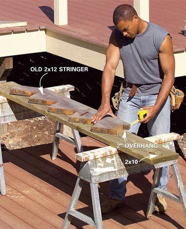 <b>Photo 13: Duplicate the old stringers</b></br> Trace the stair layout onto a 2x10 using an old stringer as a pattern. Cut and test-fit the stringer. Then use it as a pattern to cut three more stringers.