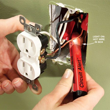 <b>Photo 2: Test for hot wires</b></br> Test for hot wires. Pull out the receptacle and push the tester deep into the box to check for other hot wires. If you find them, turn them off at the main panel.