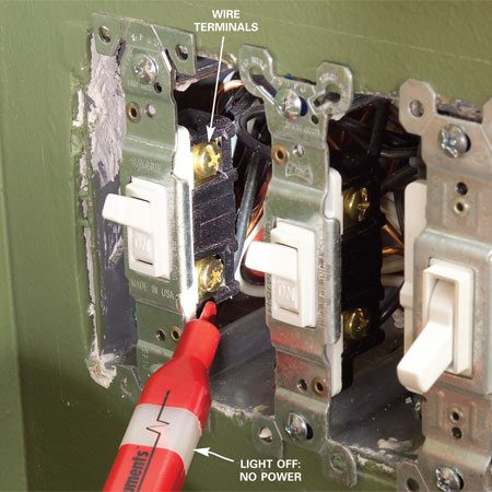 <b>Photo 3: Test switches</b></br> Test switches to make sure the power is off. Turn the power off at the main panel, remove the cover plate and push the tester nose close to one, then the other, of the two switch wire terminals to see if either wire is still hot. Check all switches.