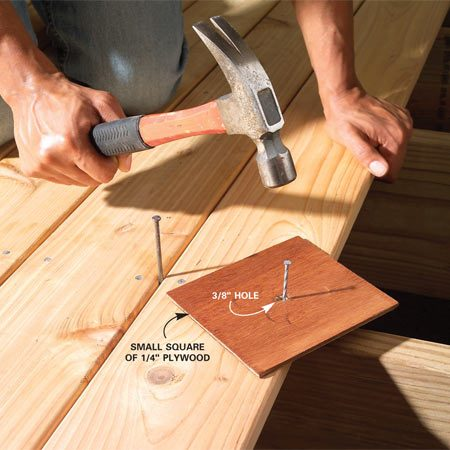 <b>Deck-saver trick</b></br> Start the nail. Then slip a small square of 1/4-in. plywood over the nail and swing away. Remove the plywood for the last blow.