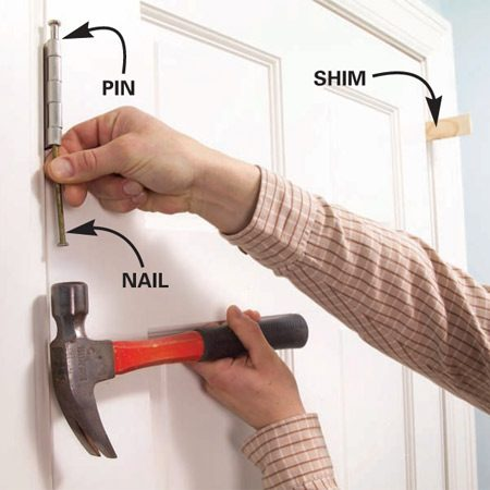<b>Photo 1: Remove the hinge pin</b></br> Shim the door and knock out the upper hinge pin.