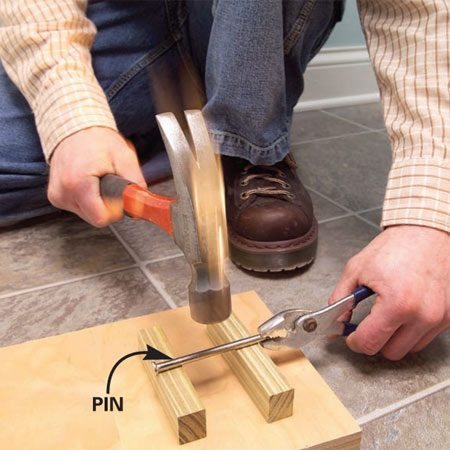 <b>Photo 2: Bend the hinge pin</b></br> Hit the hinge pin with a hammer. The bent pin should keep the door from swinging open on its own.