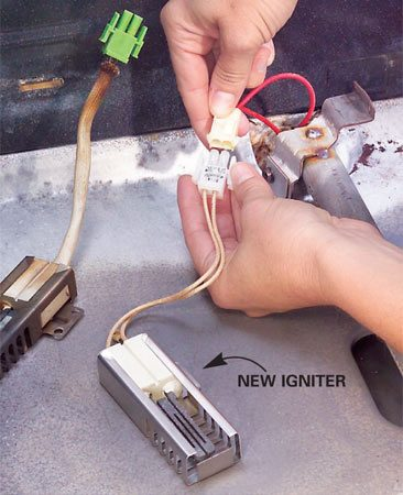 <b>Photo 2: Install the new igniter</b></br> Disconnect the terminals and plug in a new igniter. Reinstall it. Tuck the wires back down and attach the igniter with screws.