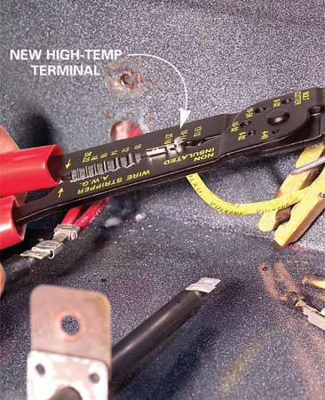 "<b>Photo 2: Crimp the new terminal</b></br> Slip the stripped wire into the new terminal. Align the barrel of the terminal with the 14-16 wire gauge notch labeled ""noninsulated."" Squeeze to crimp the terminal onto the wire."