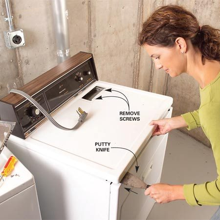<b>Photo 2: Replace the heating element - Open the top</b></br> Unscrew the two screws that hold the lint catcher to the top. Then slide a stiff putty knife under the front corners and lift to unhook the lid. Tilt it up to expose the top bracket of the heating element compartment.