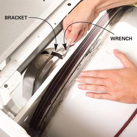 <b>Photo 3: Remove the top bracket</b></br> Unscrew the top bracket from the dryer frame and remove the bracket.