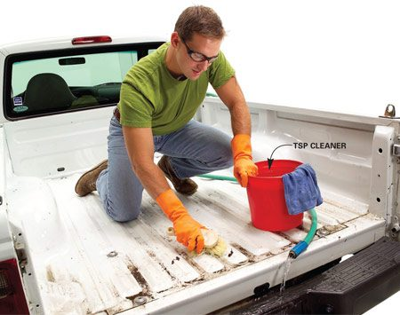 <b>Photo 1: Wash</b></br> <p>Remove the tailgate and set it on sawhorses. Sweep or vacuum dirt and debris from the bed and tailgate. Make sure any drain holes are clear. Scrub both the bed and the tailgate with a strong solution of TSP and water to remove oil, petroleum or wax-based residue. You may also need to use chemical removers and a scraper. (Follow the directions that come with the kit you select.) Rinse with plenty of clear water and wipe with a clean rag. Allow to dry thoroughly.</p>