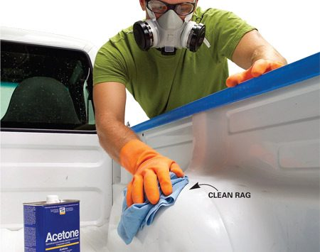 <b>Photo 4: Wipe</b></br> Wipe the bed area with acetone. Wear chemical- resistant gloves and a respirator. Start at the front of the bed using the spray bottle. Let the acetone sit for a few seconds and wipe it off with clean shop towels, never using the same side of the towel twice. Wipe the entire surface of the bed where the material is to be applied. Let dry about 10 minutes. (Never use lacquer or alcohol-based solvents.)