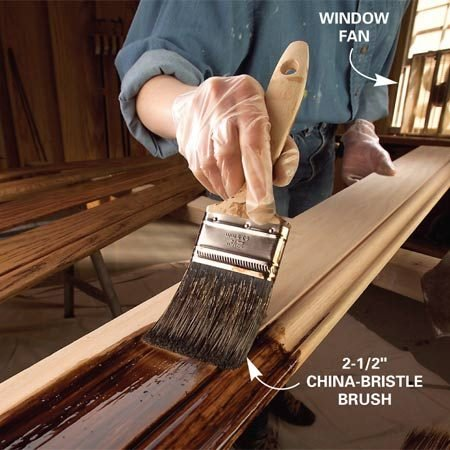 <b>Photo 4: Brush the stain</b></br> Saturate the wood with stain by brushing a liberal coat quickly over the entire surface.
