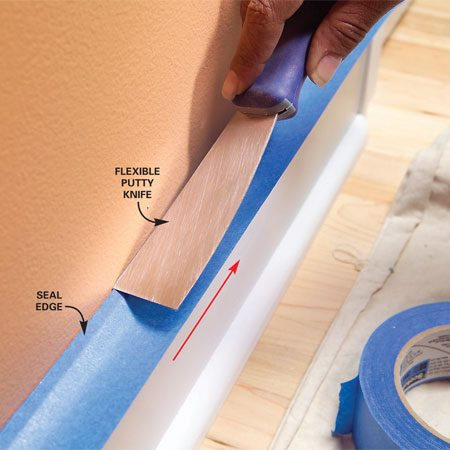 <b>Seal the edge</b></br> Run the blade of a flexible putty knife along the edge of the tape. Apply firm pressure but avoid wrinkling or tearing the tape.