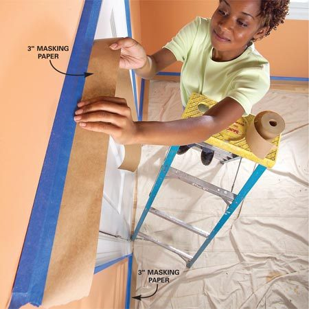 <b>Use masking paper to protect woodwork</b></br> Stick 3-in. masking paper to the underside of the tape to shield trim from paint spatters and drips.