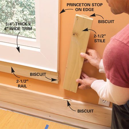 <b>Photo 10: Add rails and stiles at windows</b></br> Fit 2-1/2-in. rails under the windows, biscuit the ends and then nail them into place. Fit the stiles to the window trim, then cut the biscuit slots.