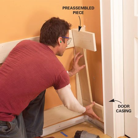 <b>Photo 12: Preassemble small sections</b></br> Preassemble small rail and stile sections in tight areas and nail or glue them into place as a unit. Prefit and trim corner boards for a perfect fit.