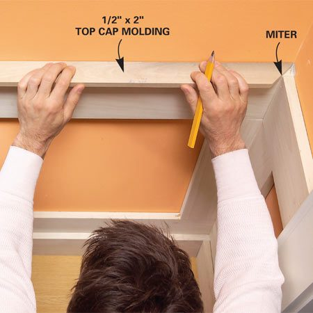 <b>Photo 15: Add the cap molding</b></br> Fit the top cap molding and nail it to the top rails. Round the corner (Photo 16) to fit it against the window and door casing.
