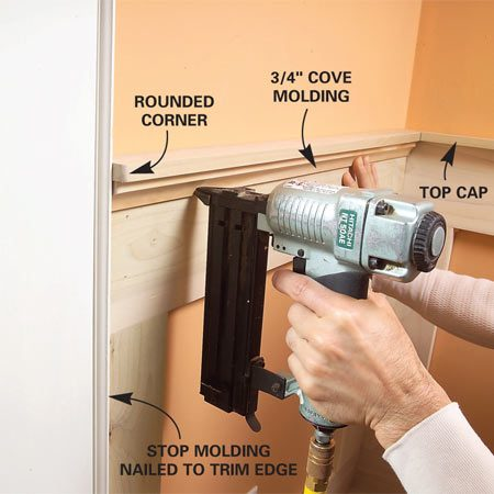 <b>Photo 16: Nail the cove</b></br> Nail the cove molding tightly under the cap molding. This will hide the nails that hold the top rail.