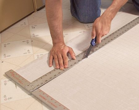 <b>Photo 6: Score and snap the backer board</b></br> Make straight cuts with a scoring knife. Make three or four scoring passes, then snap the backer over a 2x4. When all the pieces have been laid out, label them and set them aside.