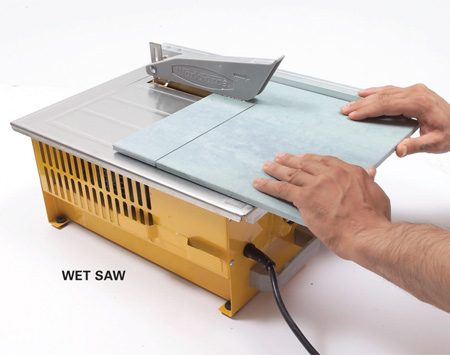 <b>Wet saw</b></br> A wet saw cuts with a diamond blade while water cools the blade and eliminates dust. You can cut notches, trim off tiny slivers of tile, cut miters and even make curves. You'll get clean cuts in any type of tile. But wet saws are messy. They spit water and raise a cloud of gritty mist. If you use one indoors, contain the mist with curtains of plastic film and cover nearby surfaces. You can buy a small wet saw like the one shown here or rent a professional model from a tile store or home or rental center. If you only have a few cuts that require a wet saw, call a tile store. Many make cuts for a small fee.